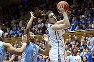03 March 2013: Duke's Haley Peters (right) and North Carolina's Danielle Butts (10). The Duke University Blue Devils played the University of North Carolina Tar Heels at Cameron Indoor Stadium in Durham, North Carolina in a 2012-2013 NCAA Division I and Atlantic Coast Conference women's college basketball game. Duke won the game 65-58.