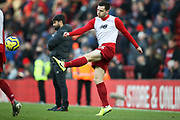 Liverpool defender Andrew Robertson (26) warming up during the Premier League match between Liverpool and Brighton and Hove Albion at Anfield, Liverpool, England on 30 November 2019.