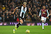 Newcastle United froward Joelinton (9) sprints forward with the ball during the Premier League match between Aston Villa and Newcastle United at Villa Park, Birmingham, England on 25 November 2019.