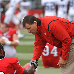 Sep 12, 2009; Piscataway, NJ, USA;  Rutgers head coach Greg Schiano shakes hands with offensive lineman Desmond Wynn (70) during warmups before Rutgers' 45-7 victory over Howard in NCAA College Football at Rutgers Stadium.