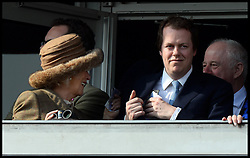 The Duchess of Cornwall collects her winnings from her son Tom Parker Bowles as she has a winner in the first race at the Cheltenham Festival Ladies Day. Cheltenham Racecourse, Cheltenham, United Kingdom. Wednesday, 12th March 2014. Picture by Andrew Parsons / i-Images