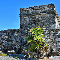 God of Winds Temple at Mayan Ruins in Tulum, Mexico<br /> The Templo Dios del Viento is perched on circular platform on top of a cliff overlooking the sea.  It is devoted to Hurac&aacute;n who was the one-legged Mayan god of the wind as well storms and fire.  This mythological deity, which is also spelled Hunraqan, is the origin for the word &ldquo;hurricane.&rdquo;