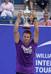 LIVERPOOL, ENGLAND - Sunday, June 23, 2019: Runner-up Robert Kendrick (USA) takes hold of the trophy after the Men's Final on Day Four of the Liverpool International Tennis Tournament 2019 at the Liverpool Cricket Club. <br /> Lorenzi won 7-6 (3), 6-2. (Pic by David Rawcliffe/Propaganda)