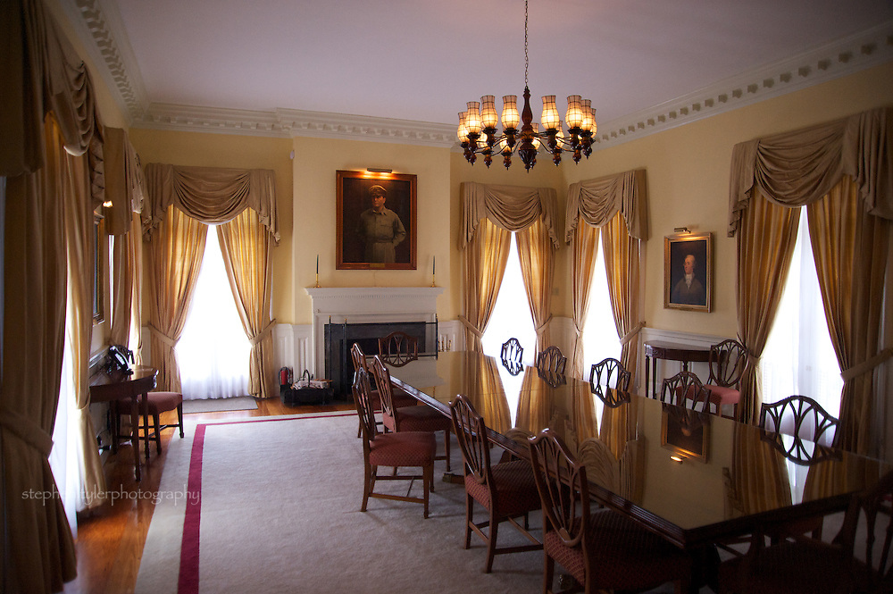 Dining room of the Ambassador's Residence of the U.S. Embassy displays Fernando Amorsolo's 1951 portrait of General Douglas MacArthur above the fireplace. Portrait of Alexander Hamilton as the 1st U.S. Secretary of the Treasury (1757-1804) hangs on the adjacent wall, painted by Casimir G. Stapko in 1949.