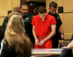 Nikolas Cruz appears in court for a status hearing before Broward Circuit Judge Elizabeth Scherer on Monday, Feb. 19, 2018. Cruz faces 17 charges of premeditated murder in the mass shooting at Marjory Stoneman Douglas High School in Parkland, FL, USA Photo by Mike Stocker/Sun Sentinel/TNS/ABACAPRESS.COM