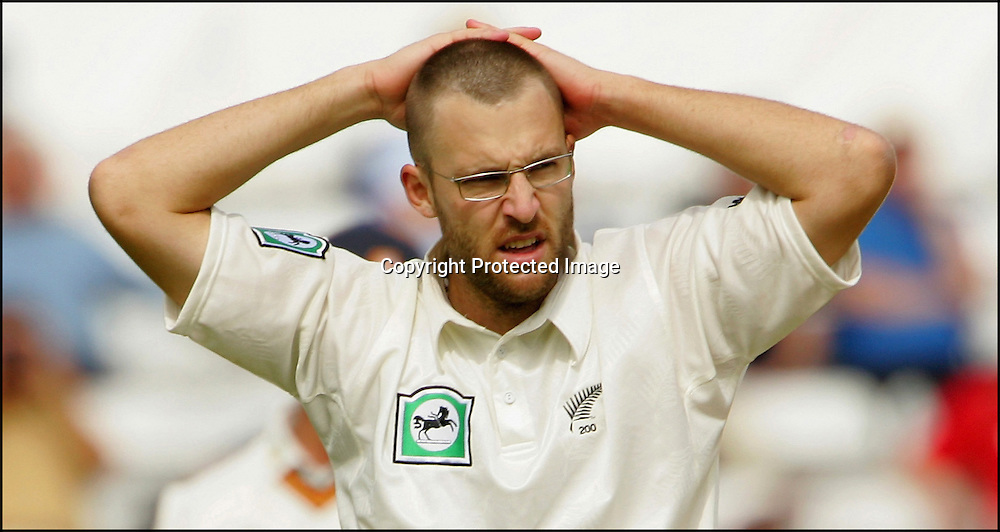 Daniel Vettori of New Zealand holds his head at Chelmsford on the second day of the match against Essex on the 3rd of May 2008.<br />