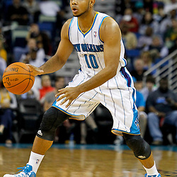 December 21, 2011; New Orleans, LA, USA; New Orleans Hornets shooting guard Eric Gordon (10) handles the ball against the Memphis Grizzlies during the second quarter of a game at the New Orleans Arena.   Mandatory Credit: Derick E. Hingle-US PRESSWIRE