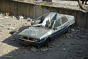 Israel, Haifa, An apartment building hit by a missile March 30th 2006 Damaged car in the parking lot