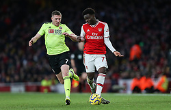 Bukayo Saka of Arsenal  passes the ball under pressure from John Lundstram of Sheffield United - Mandatory by-line: Arron Gent/JMP - 18/01/2020 - FOOTBALL - Emirates Stadium - London, England - Arsenal v Sheffield United - Premier League