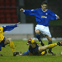 St Johnstone v Queen of the South....20.12.03<br />Ross Forsyth skips a tackle by Sean O'Connor<br /><br />Picture by Graeme Hart.<br />Copyright Perthshire Picture Agency<br />Tel: 01738 623350  Mobile: 07990 594431