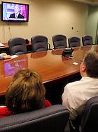 Kelly Kohls of Springboro (left) and Dr. Tony Corvo of Beavercreek watch the Republican debate in Arizona, Wednesday, February 22, 2012.