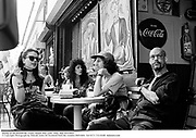 Sitting on the Boardwalk. Coney Island. New york. 1992. film 92519f22<br />© Copyright Photograph by Dafydd Jones<br />66 Stockwell Park Rd. London SW9 0DA<br />Tel 0171 733 0108  dafjones.com