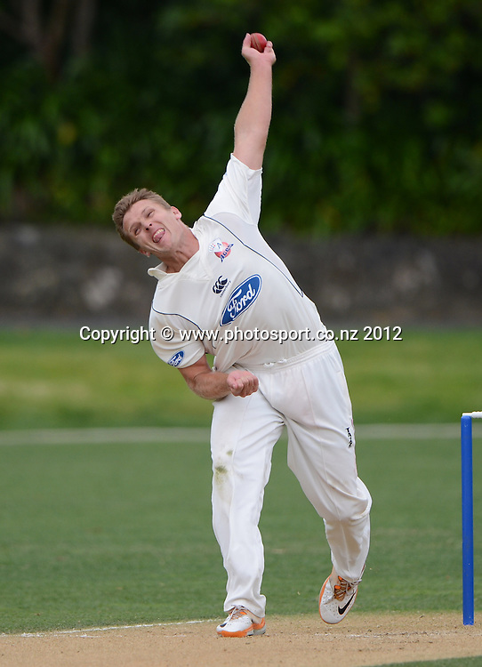 Michael Bates bowling for Auckland. Plunket Shield Cricket, Auckland Aces v Northern Knights at Eden Park Outer Oval. Monday 12 November 2012. Photo: Andrew Cornaga/Photosport.co.nz