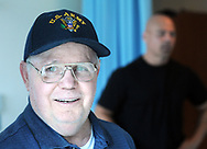 Ken Keene Sr. speaks about living with early onset dementia as his son Ken Keene Jr. stands in the background Thursday, August 31, 2017 at the Delaware Valley Veterans Home in Philadelphia, Pennsylvania. (WILLIAM THOMAS CAIN / For The Philadelphia Inquirer)