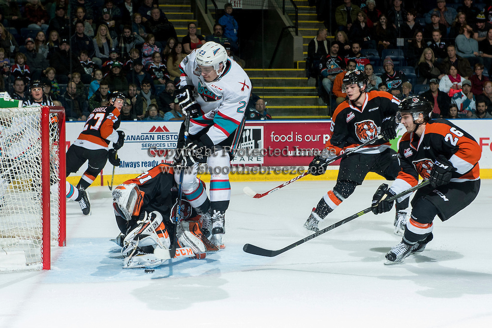 KELOWNA, CANADA - JANUARY 23:  Justin Kirkland #23 of Kelowna Rockets attempts a goal against Nick Schneider #31 of Medicine Hat Tigers on January 23, 2016 at Prospera Place in Kelowna, British Columbia, Canada.  (Photo by Marissa Baecker/Shoot the Breeze)  *** Local Caption *** Nick Schneider; Justin Kirkland;
