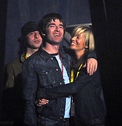 Noel Gallagher and girlfriend backstage before Paul Weller performs, T in the Park, Balado, Fife, 7/7/2001..©2010 Michael Schofield. All Rights Reserved.