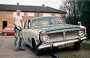 Paul by a Car, Hawthorne Road, High Wycombe, UK, 1980s.