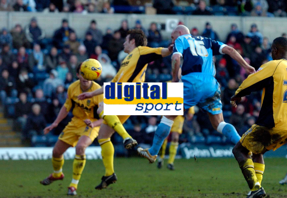 Photo: Richard Lane.<br />Wycombe Wanderers v Oxford United. Coca Cola League 2. 25/02/2006. <br />Wycombe's Tommy Mooney heads in his side's second goal.
