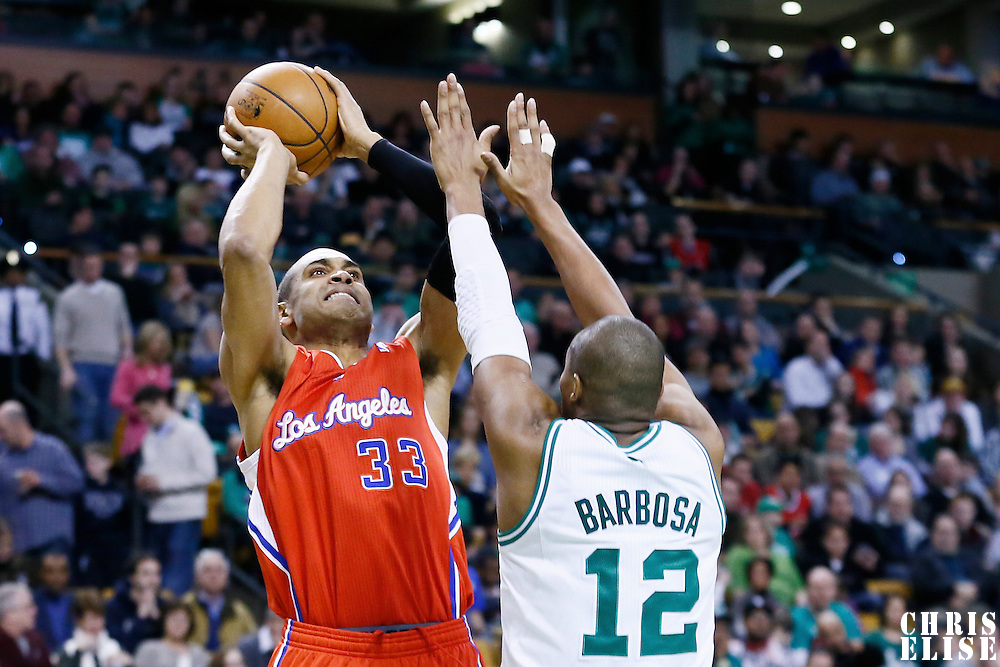 03 February 2013: Los Angeles Clippers small forward Grant Hill (33) takes a jumpshot over Boston Celtics shooting guard Leandro Barbosa (12) during the Boston Celtics 106-104 victory over the Los Angeles Clippers at the TD Garden, Boston, Massachusetts, USA.