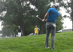 August 12, 2018 - St. Louis, Missouri, U.S. - ST. LOUIS, MO - AUGUST 12: Dustin Johnson hits from the rough on to the #1 green during the final round of the PGA Championship on August 12, 2018, at Bellerive Country Club, St. Louis, MO.  (Photo by Keith Gillett/Icon Sportswire) (Credit Image: © Keith Gillett/Icon SMI via ZUMA Press)