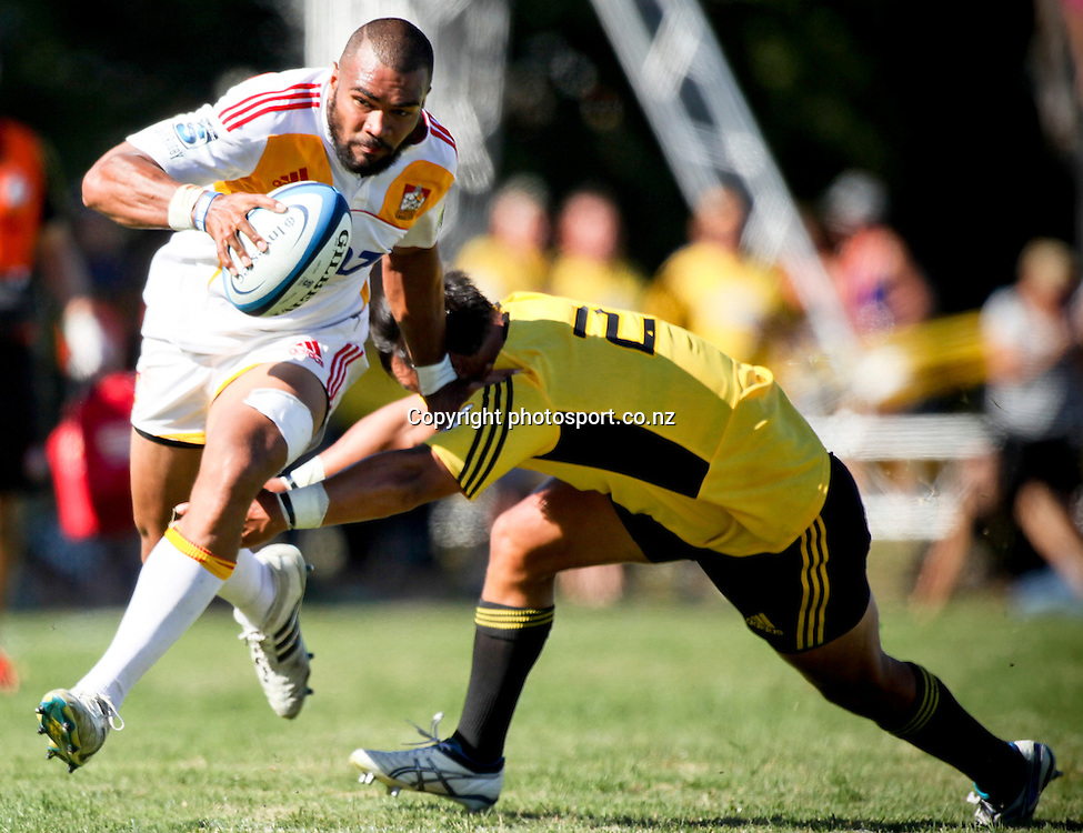 Chief's Patrick Osborne makes a break during the preseason Super Rugby match against the Hurricanes, Mangatainoka Rugby Football Club, Mangatainoka,  New Zealand. Saturday, 16 February, 2013. Photo: Bethelle McFedries / photosport.co.nz