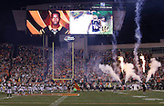 Photographs of Cincinnati Bengals wide receiver A.J. Green (18) are shown on the Paul Brown Stadium scoreboard in this general view, wide angle photograph of the stadium interior taken during pregame player introductions with a smoke and fire display used before the Cincinnati Bengals NFL AFC Wild Card playoff football game against the Pittsburgh Steelers on Saturday, Jan. 9, 2016 in Cincinnati. The Steelers won the game 18-16. (©Paul Anthony Spinelli)