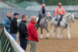 Mark, center, and Norman Casse watch Derby 142 hopeful workout during training, Tuesday, May 03, 2016 at Churchill Downs in Louisville.