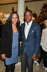 KOJO & SHANTHI ANNAN he is the son of ex-UN Secretary-General Kofi Annan at the London debut of Nest - an organisation to promote peace and prosperity in partnership with artisans worldwide, held at Thomas Goode & Co, South Audley Street, London on 4th November 2014.