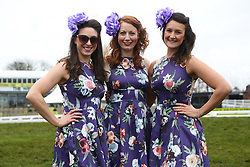 © Licensed to London News Pictures. 08/04/2016. Liverpool, UK. Three women wearing matching hats and dresses pose on Ladies Day at the Grand National 2016 at Aintree Racecourse near Liverpool. The race, which was first run in 1839, is the most valuable jump race in Europe. Photo credit : Ian Hinchliffe/LNP