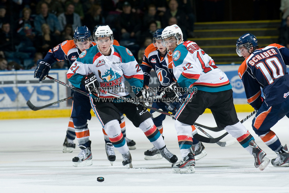KELOWNA, CANADA, JANUARY 25: Brett Lyon #21 and Tyrell Goulbourne #12 of the Kelowna Rockets skate on the ice as the Kamloops Blazers visit the Kelowna Rockets on January 25, 2012 at Prospera Place in Kelowna, British Columbia, Canada (Photo by Marissa Baecker/Getty Images) *** Local Caption ***