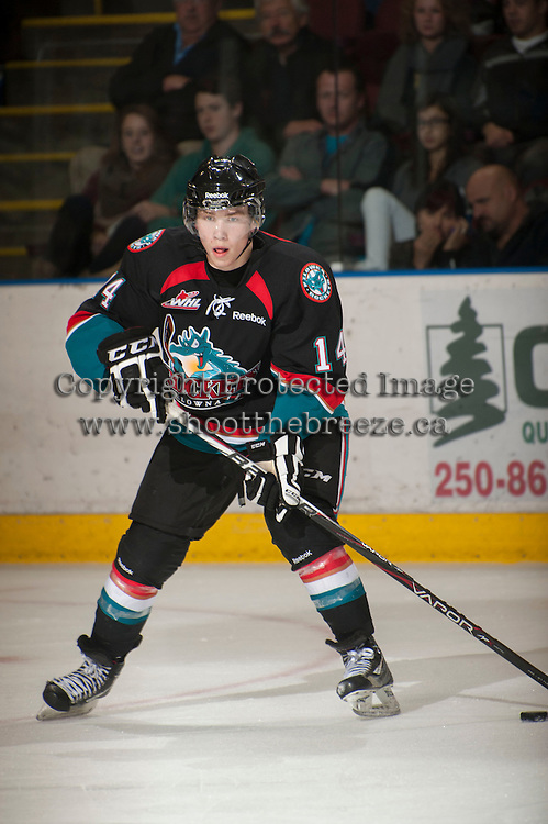 KELOWNA, CANADA - OCTOBER 18:  Rourke Chartier #14 of the Kelowna Rockets skates on the ice as the Prince George Cougars visit the Kelowna Rockets on October 18, 2012 at Prospera Place in Kelowna, British Columbia, Canada (Photo by Marissa Baecker/Shoot the Breeze) *** Local Caption ***