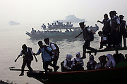 INDONESIA, Palembang : 20 October 2015 Students stand on the wooden boat as they cross the river as haze shrouded the Ogan river on the way to school. Forest fires in Sumatra and Borneo have caused widespread haze in Southeast Asia. Pic by Bagus Kurniawan / Story Picture Agency