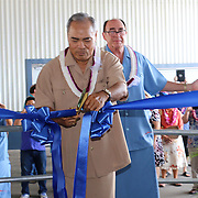 Hon. Governor Lolo Moliga cuts the ribbon to formally celebrate the STP/TriMarine Cannery Innauguration ceremonies and festivities, Satala, Tutuila, American Samoa. 1/24/15,  Photo by Barry Markowitz.