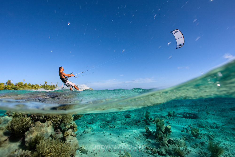 Professional Kiteboarder Moehau Goold kiting the beautiful waters of French Polynesia.