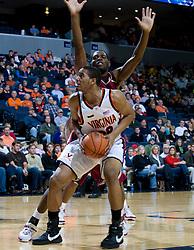 Virginia forward Mike Scott (32) in action against Elon.  The Virginia Cavaliers men's basketball team defeated the Elon Phoenix 91-61  at the John Paul Jones Arena in Charlottesville, VA on December 22, 2007.