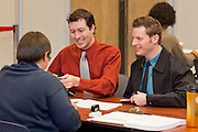 Feb. 9, 2009 -- PHOENIX, AZ: JARED WEST, left, and his partner, RONNIE CONNER register as domestic partners with Phoenix city employee MARY JO SLUNDER in city hall. The city of Phoenix initiated its Domestic Partners Registry Monday morning. Under the terms of the registry, unmarried couples, whether gay or straight, can register as domestic partners to gain visitation and decision making rights if one of them, or one of their children, is hospitalized. They were the second couple to publicly register as domestic partners. Gay and domestic partner rights has become a hot button issue in Arizona since voters in the state passed an anti-gay marriage amendment in November that defines marriage as being between one man and one woman.  PHOTO BY JACK KURTZ