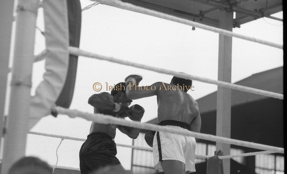 Ali vs Lewis Fight, Croke Park,Dublin.<br /> 1972.<br /> 19.07.1972.<br /> 07.19.1972.<br /> 19th July 1972.<br /> As part of his built up for a World Championship attempt against the current champion, 'Smokin' Joe Frazier,Muhammad Ali fought Al 'Blue' Lewis at Croke Park,Dublin,Ireland. Muhammad Ali won the fight with a TKO when the fight was stopped in the eleventh round.<br /> <br /> A left cross by Ali sends Lewis back across the ring.