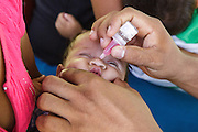 A health worker vaccinates a child against polio during a vaccination session at the primary school in the town of Coyolito, Honduras on Wednesday April 24, 2013.