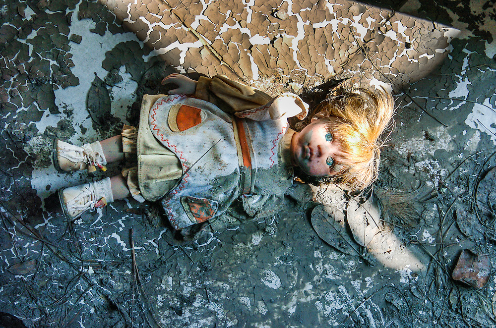 A doll lies in the mud after floating from the upstairs bedroom of a five-year-old girl to the bottom floor of a New Orleans home after Hurricane Katrina and the subsequent levee failures caused massive flooding in New Orleans. The doll was a gift from the girl's grandfather who died shortly after he evacuated to Texas. www.kathyandersonphotography.com