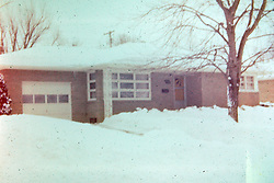 Photos taken by George Look.  Image started as a color slide.  Converted to black and white via computer software.  Dust and other artifacts may exist.<br /> <br /> <br /> Winter 1974. S. Eighth Street, Pekin Illinois.