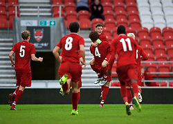 ST HELENS, ENGLAND - Wednesday, October 24, 2018: Liverpool's Rhys Williams celebrates scoring the winning second goal with team-mate captain Adam Lewis during the UEFA Youth League Group C match between Liverpool FC and FK Crvena zvezda at Langtree Park. Liverpool's won 2-1. (Pic by David Rawcliffe/Propaganda)