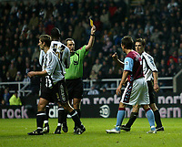 Photo: Andrew Unwin.<br />Newcastle Utd v Aston Villa. The Barclays Premiership.<br />03/12/2005.<br />Aston Villa's Lee Hendrie (R) is shown the yellow card by the referee, Alan Wiley, for diving.