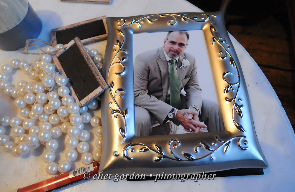 Framed print of groom Steve Mona during his wedding reception at the Metropolitan Building in Long Island City, NY on Saturday, November 16, 2013.  © Chet Gordon • Photographer