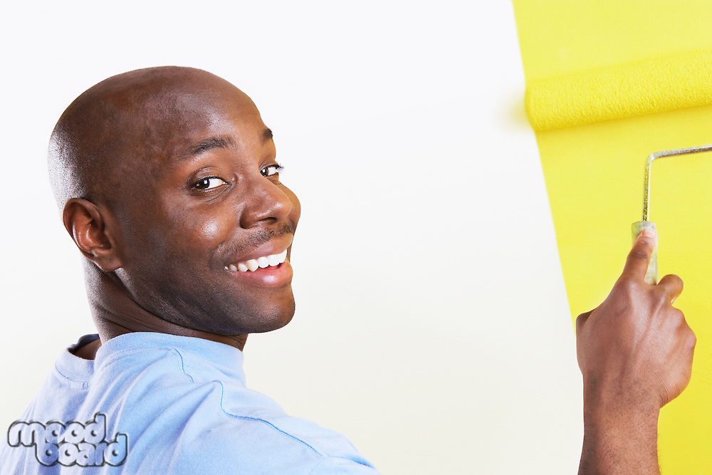 Man Painting Wall Yellow
