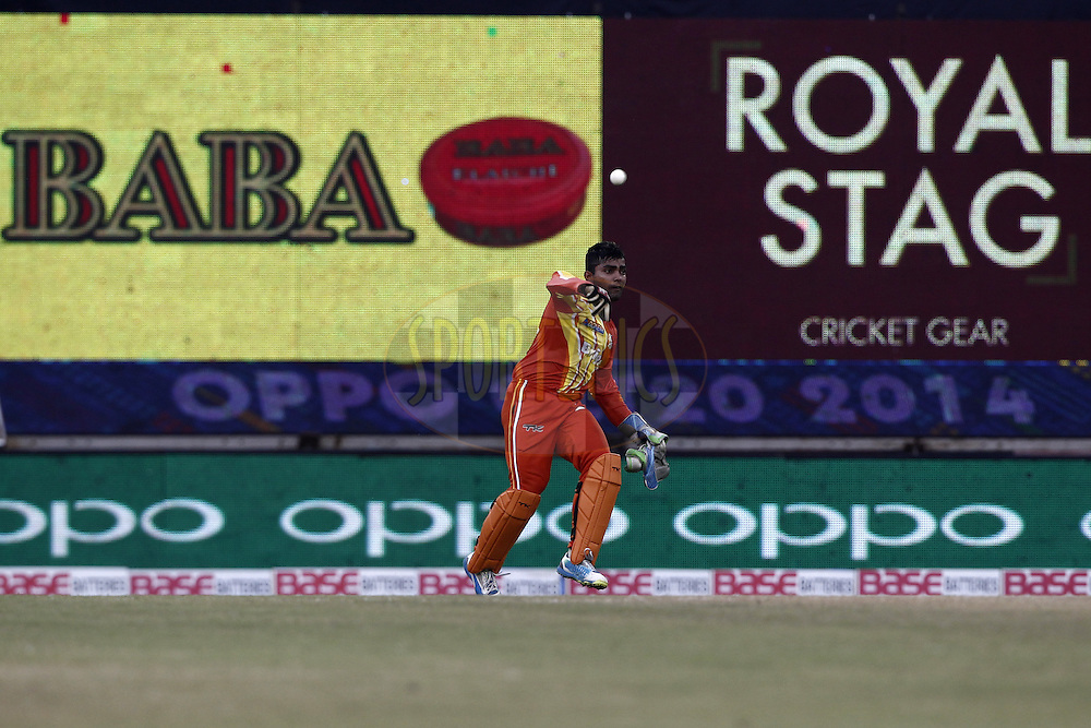 Umar Akmal of the LAHORE LIONS during the qualifier 3 match of the Oppo Champions League Twenty20 between the Northern Knights and the Lahore Lions held at the Chhattisgarh International Cricket Stadium, Raipur, India on the 14th September 2014<br /> <br /> Photo by:  Deepak Malik / Sportzpics/ CLT20<br /> <br /> <br /> Image use is subject to the terms and conditions as laid out by the BCCI/ CLT20.  The terms and conditions can be downloaded here:<br /> <br /> http://sportzpics.photoshelter.com/gallery/CLT20-Image-Terms-and-Conditions-2014/G0000IfNJn535VPU/C0000QhhKadWcjYs