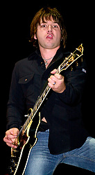 Quireboys lead guitarist luke bossendorfer performing on stage at the Monsters of Rock Festival. The last night of an eleven date tour at the Hallam FM Arena, Sheffield on Tuesday 26th November 2002<br /> <br /> Copyright Paul David Drabble<br /> Freelance Photographer<br /> 07831 853913<br /> 0114 2468406<br /> www.pauldaviddrabble.co.uk<br /> [#Beginning of Shooting Data Section]<br /> Nikon D1 <br /> 2002/11/26 20:19:01.1<br /> JPEG (8-bit) Fine<br /> Image Size:  2000 x 1312<br /> Color<br /> Lens: 80-200mm f/2.8-2.8<br /> Focal Length: 86mm<br /> Exposure Mode: Manual<br /> Metering Mode: Spot<br /> 1/250 sec - f/2.8<br /> Exposure Comp.: 0 EV<br /> Sensitivity: ISO 400<br /> White Balance: Auto<br /> AF Mode: AF-S<br /> Tone Comp: Normal<br /> Flash Sync Mode: Front Curtain<br /> Auto Flash Mode: External<br /> Color Mode: <br /> Hue Adjustment: <br /> Sharpening: Normal<br /> Noise Reduction: <br /> Image Comment: <br /> [#End of Shooting Data Section]