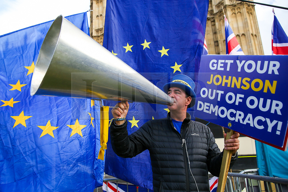 © Licensed to London News Pictures. 01/10/2019. London, UK. Anti Brexit and Pro-EU campaigner STEVE BRAY blows into his megaphone outside Houses of Parliament with thirty days remaining until Brexit Day. It has been reported that Prime Minster Boris Johnson has asked EU to rule out a further Brexit extension as part of a proposed new deal for the UK's departure from the bloc.Photo credit: Dinendra Haria/LNP