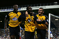 Photo: Lee Earle.<br /> Portsmouth v Wigan Athletic. The Barclays Premiership. 05/11/2005. Wigan's Pascal Chimbonda (C) is congratulated by Jason Roberts (L) and Lee McCulloch (R).