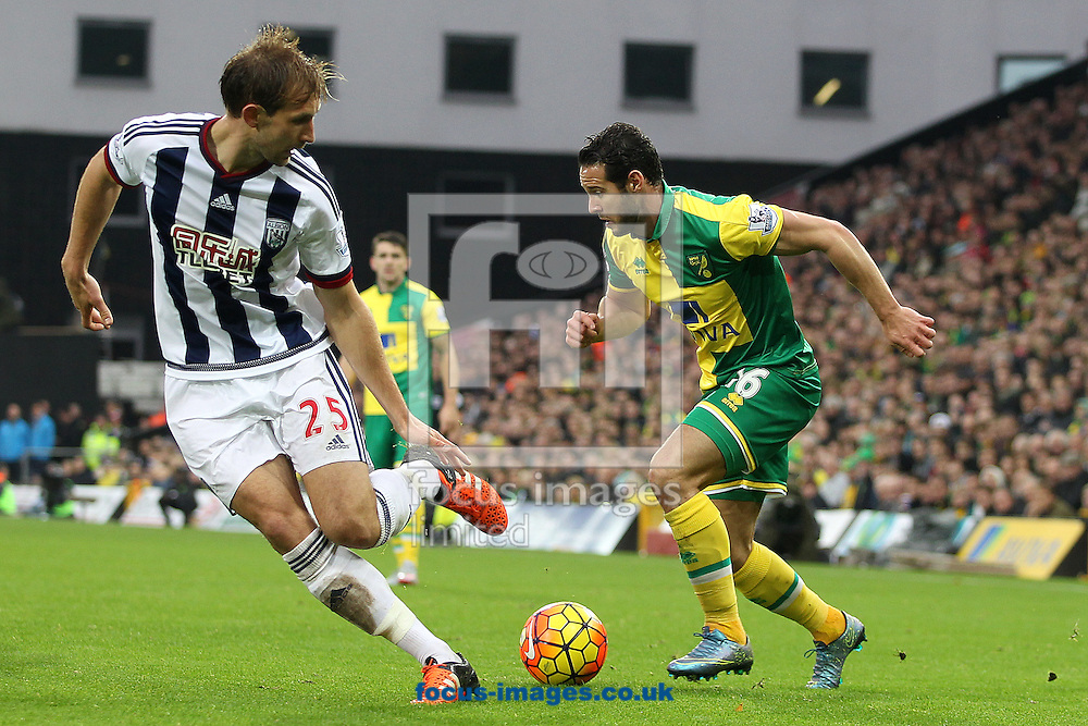 Matt Jarvis of Norwich and Craig Dawson of West Bromwich Albion in action during the Barclays Premier League match at Carrow Road, Norwich<br /> Picture by Paul Chesterton/Focus Images Ltd +44 7904 640267<br /> 24/10/2015