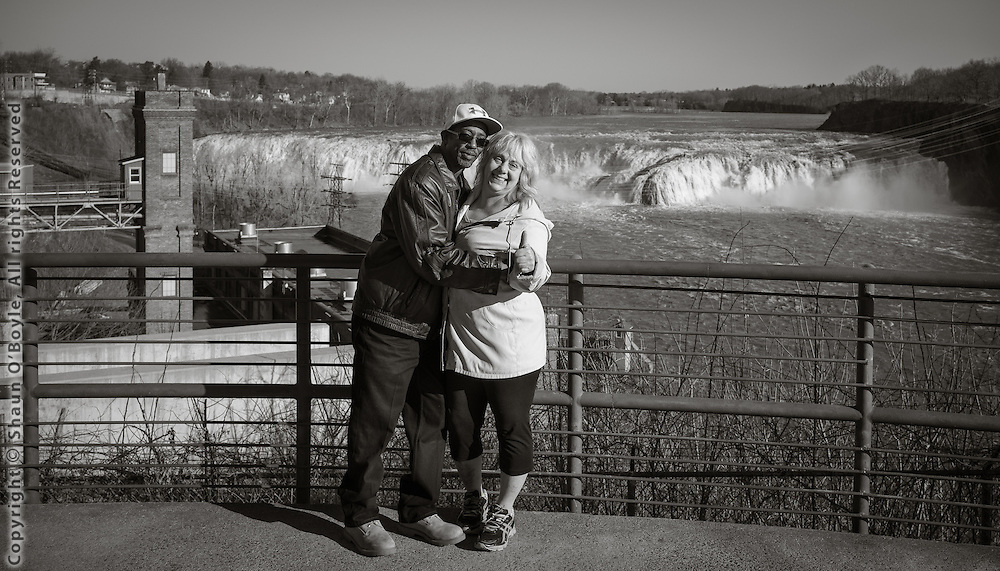 Couple at Cohoes Falls overlook, Mohawk River, Cohoes, NY